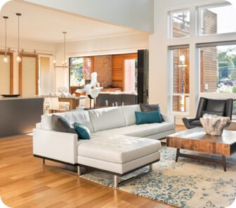 open concept living room with a white couch in the middle