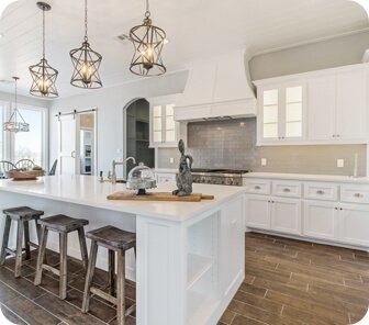 a luxurious white kitchen that is clean from top to bottom