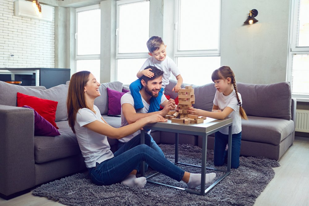 family playing at home without mould