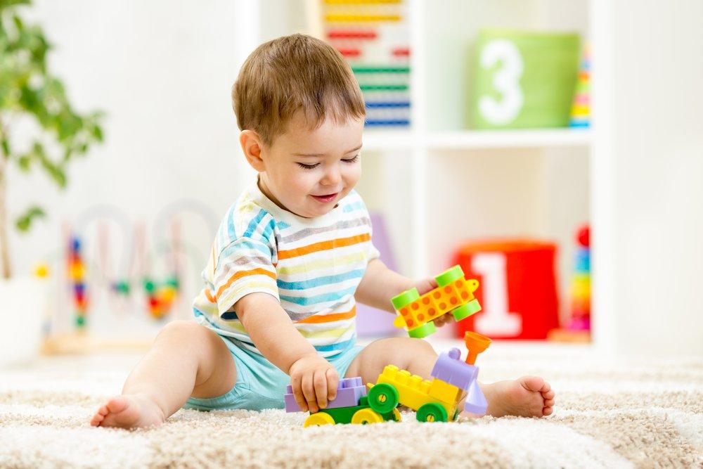 toddler playing on carpet