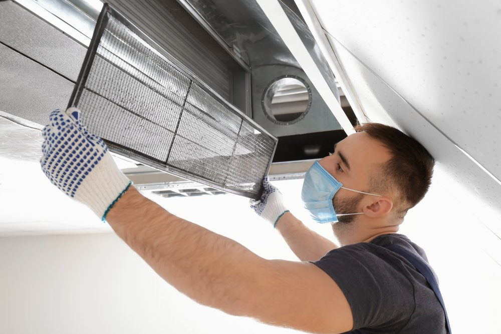 technician performing duct cleaning