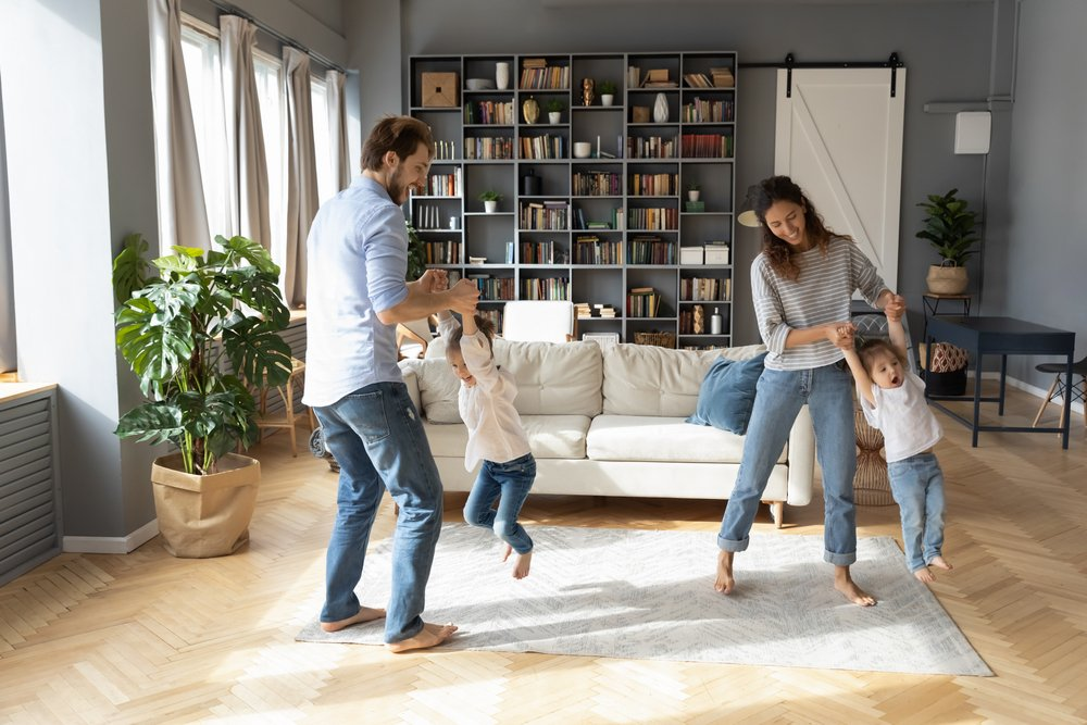 family at home breathing clean indoor air and having fun in the living room